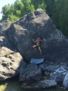 Tyler Janzen bouldering, photo: Anne Tong